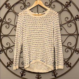 Cream sweater with blue stitch detail